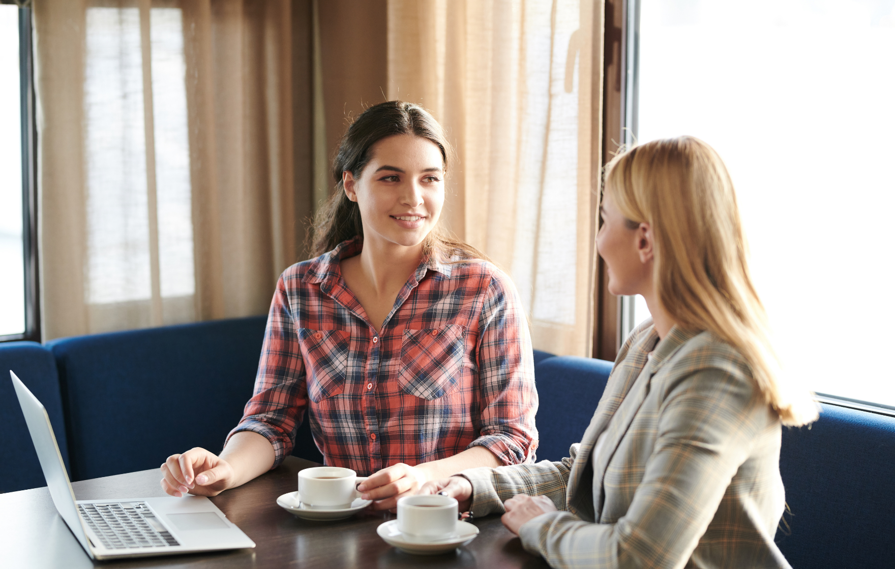 Two women talking over a coffee